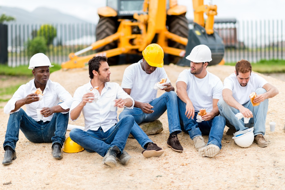 Group of construction workers on a break at a building site